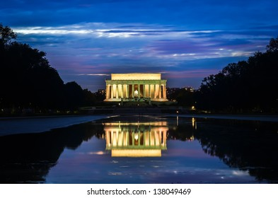 Abraham Lincoln Memorial and mirror reflection on water at night - Washington DC, United States