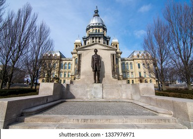 Abraham Lincoln statue standing proud in front of the state capitol building in Springfield, Illinois.