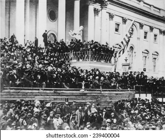 Abraham Lincoln's delivering his second inaugural address (standing, center) on the east portico of the U.S. Capitol, March 4, 1865, his second inauguration.