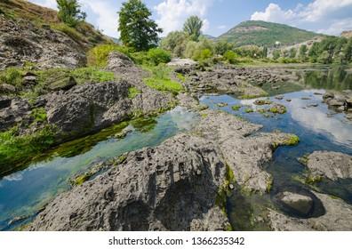 Abrasive basalt rocks at the bottom of the Arda River behind the Studen Kladenets dam, Bulgaria