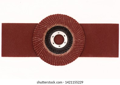 Abrasive disk  with sandpaper closeup isolated on white