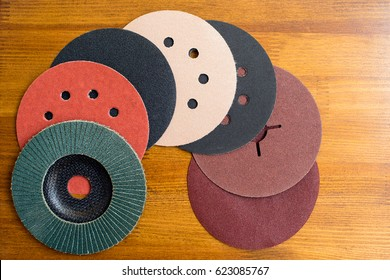 Abrasive disks for metal and stone,wood grinding, cutting. Set of abrasive materials on wooden background vertical view. Abrasive tools. tools