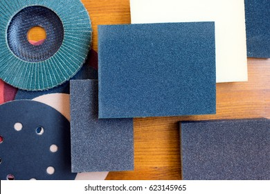 Abrasive disks for metal and stone,wood grinding, cutting. Set of abrasive materials on wooden background vertical view. Abrasive tools. Abrasive set