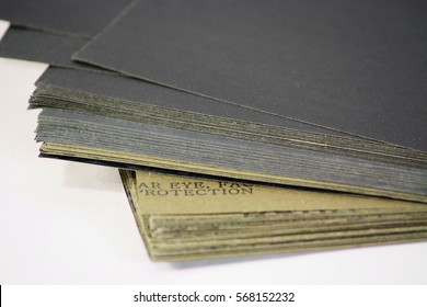Abrasive paper sheets for processing and polishing wood and metal