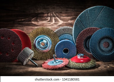 abrasive rotary wheels set on vintage wood