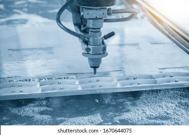 The abrasive water jet machine cutting the aluminium plate with lighting effect. The hi-technology sheet metal working process by hi-pressure water jet machine.