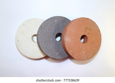 Abrasive wheels for a circular grinder, white, gray and red color on a white background