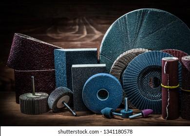 abrasives on vintage wood background