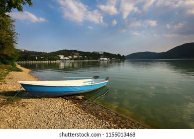 Abrau-Durso, Krasnodar Territory, Russia July 12, 2018. A beautiful view of Abrau lake and a boat on the shore in the village of Abrau-Durso