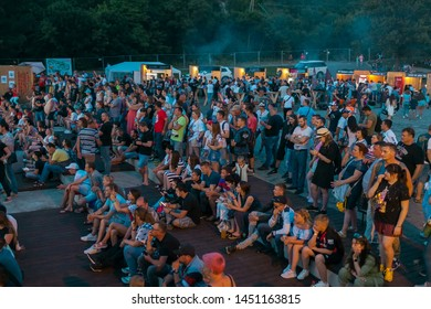 Abrau-Durso, Novorossiysk, Krasnodar Territory, Russia. 08.06.2019. Spectators stand and sit in front of the stage at the Abrau Family Bike Fest.