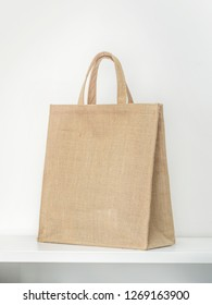 abric bag made from hessian sack with handle on white background