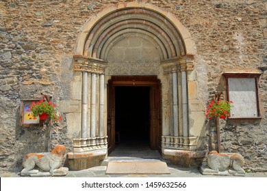 ABRIES, QUEYRAS, FRANCE - JUNE 29, 2019: The main entrance of Saint Pierre (and Saint Antoine) church, with carvings, columns and two lions statues, Queyras Regional Natural Park, Alps