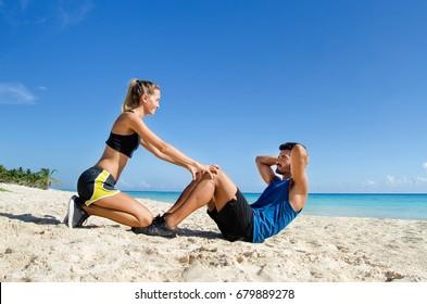 Abs crunch at the beach