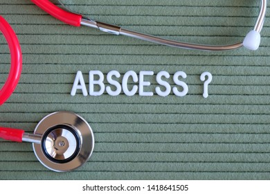 Abscess- text with a question mark on  green background with  stethoscope, medical concept diagnostics, treatment, healthcare.