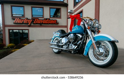 Absecon, NJ, December 10, 2016: Brand new light blue motorcycle with some Christmas decorations is seen on display just outside of a Harley-Davidson dealer.