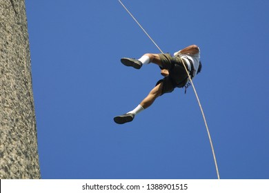 Abseiling also known as rappelling, is a controlled descent off a vertical drop, such as a rock face, using a rope. This technique is used by climbers, to descend cliffs when they are too dangerous.