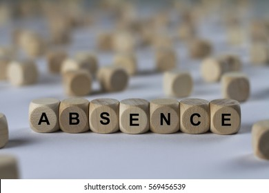 absence - cube with letters, sign with wooden cubes
