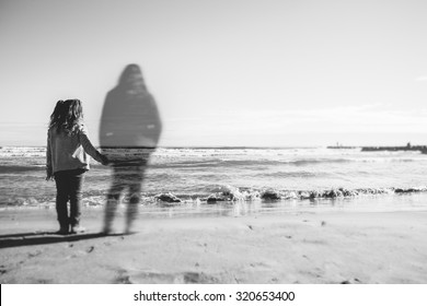 Absence: A girl holds the hand what appears to be the spirit of his dead mother. The image has been selectively blurred to give a touch of mystery