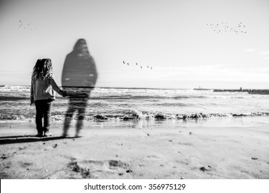 Absence: A girl holds the hand what appears to be the spirit of his dead mother. The image has been selectively blurred to give a touch of mystery. Can see some birds in the horizon.