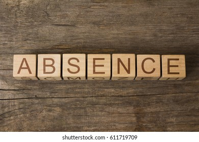 absence word on wooden cubes