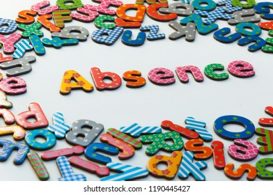 Absence word surrounded by colorful alphabet letters