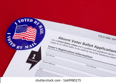 Absent voter ballot application. I voted by mail sticker. Absentee forms.