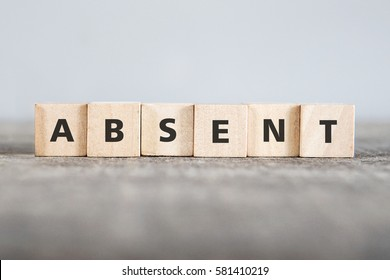 ABSENT word made with building blocks