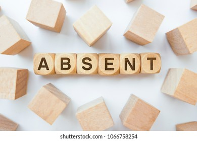 ABSENT word on wooden cubes