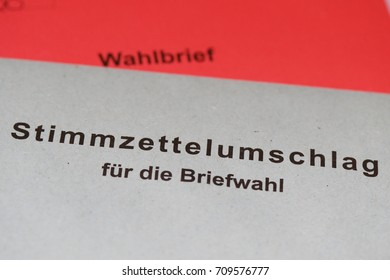 """Absentee voting_red and gray envelope. Absentee ballot in Germany with, prepaid envelope with the German word """"Wahlbrief"""" and """"Stimmzettelumschlag für die Briefwahl"""""""
