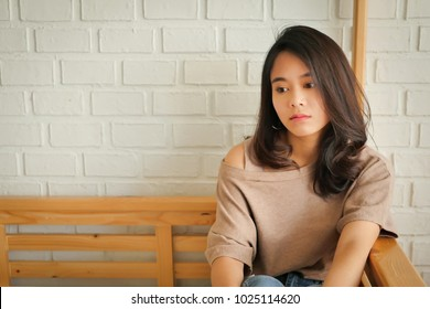 absent-minded woman sitting in apartment