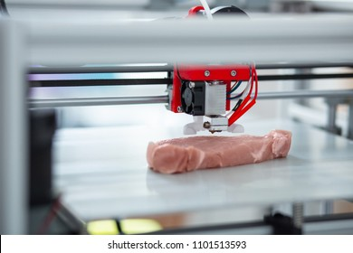 Absolutely alike. The close up of a 3D printer recreating a piece of meat, imitating all the little details
