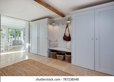 Absolutely stunning beautifully decorated entrance lobby to a residential home with cloaks cupboards, seating with storage below, coat hooks and view towards the reception room