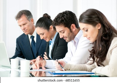 Absorbed business team working together in modern office