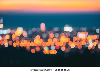 Absract Blurred Bokeh Architectural Urban Backdrop. Real Blurred Colorful Bokeh Background With Defocused Lights