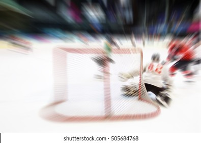absract zoom in moving ice hocky game from goal in arena
