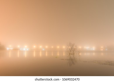 abstact blurred background of Uttamanusorn Bridge or Mon Bridge with light reflection and fog on river in the evening at Sangkhlaburi district,Kanchanaburi province,Thailand. With copy space for text