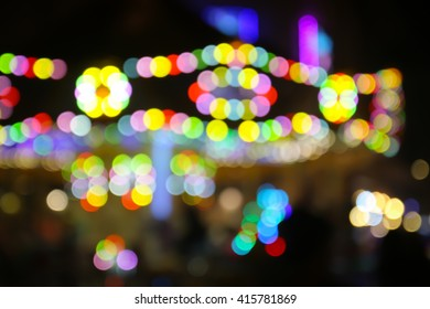 Abstact blurred bokeh of carousel - night canival