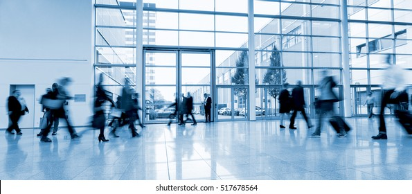 abstakt image of people at a trade fair of a modern hall motion blurred
