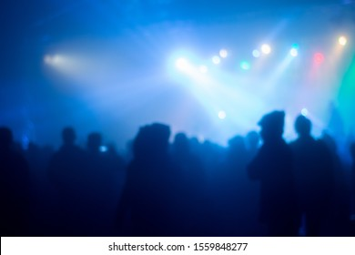 abstrac blurred images people are at a party with colorful lights