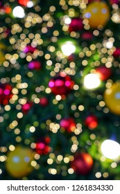 Abstrack colorful circular bokeh background of chrismaslight. Colorful chrismas background of de-focused light with Decorate chrimas tree.