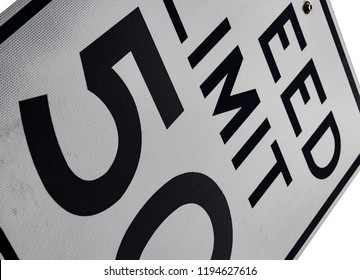 Abstract 50 MPH speed limit sign tilted on angle
