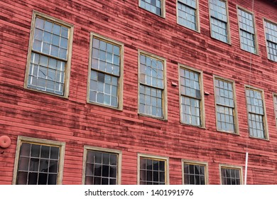Abstract abandoned old red warehouse building with windows