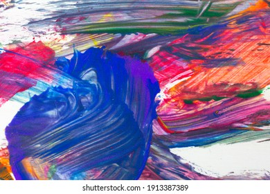 An abstract acrylic painting background with an assortment of bright colors in wide brush strokes with predominately blue.