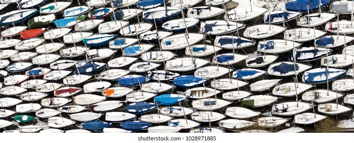 Abstract aerial view of storage of yachts in a boatyard in winter time. Boats are all packed together in this harbour in Hoorn, Netherlands. The pattern gives an abstract view.