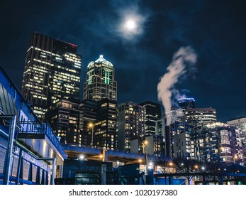 Abstract angle below night cityscape with hazy clouds