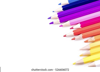 Abstract angle of multiple coloured pencils on white, with space for text