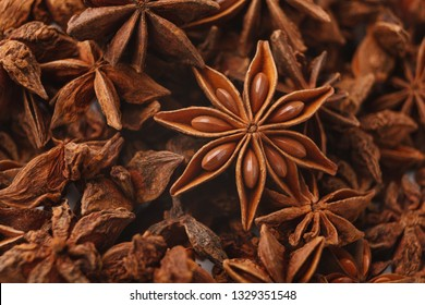 Abstract aniseed aromatic background. Anise stars condiment close up, panorama