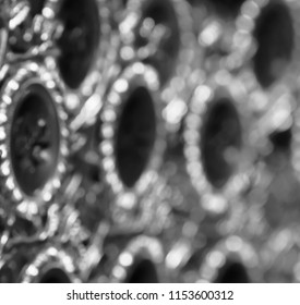 Abstract Arabic words printed on a metallic showpiece object blurry photo