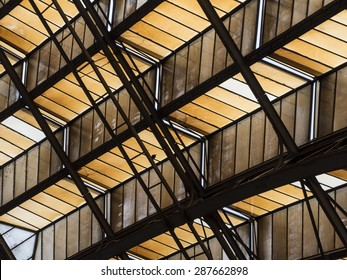 Abstract Architectural Detail of Angled Ceiling with Support Beams and Girders and Ladder for Image Backgrounds