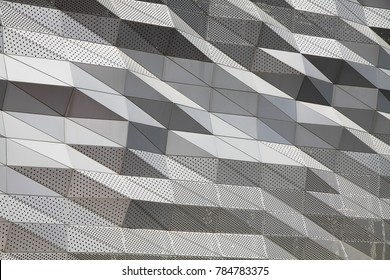 Abstract architecture background concept, Aluminium composite panels or cladding with perforated sheets on modern building facade, concept for futuristic design.